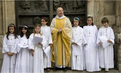 happy priest and children